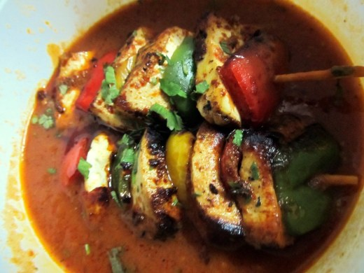 Paneer n vegetables skewered in tomato sauce
