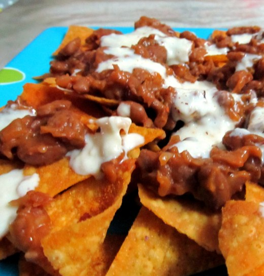 Nachos - tortilla chips topped with beans and cheese