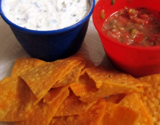Tortilla chips served with tomato salsa n curd dip
