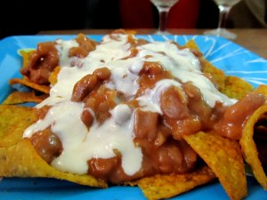 nachos with refried beans and cheese sauce
